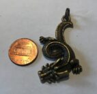 Coiled Bronze Dragon Charm